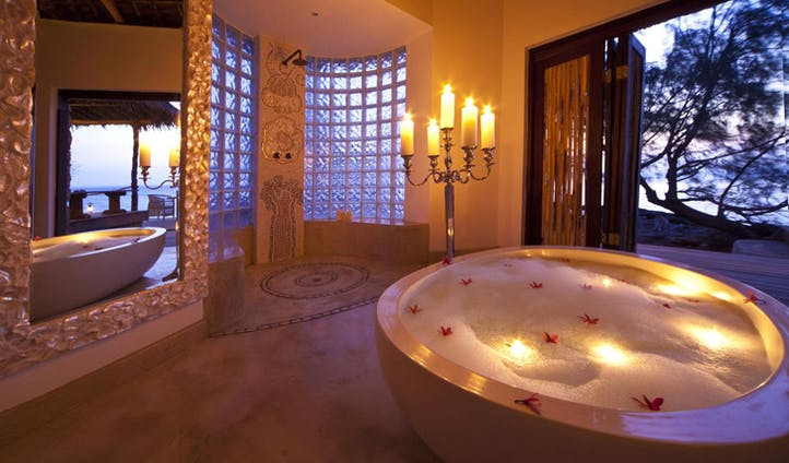 A luxurious bathroom with oversized bath at Quilalea Private Lodge, Mozambique
