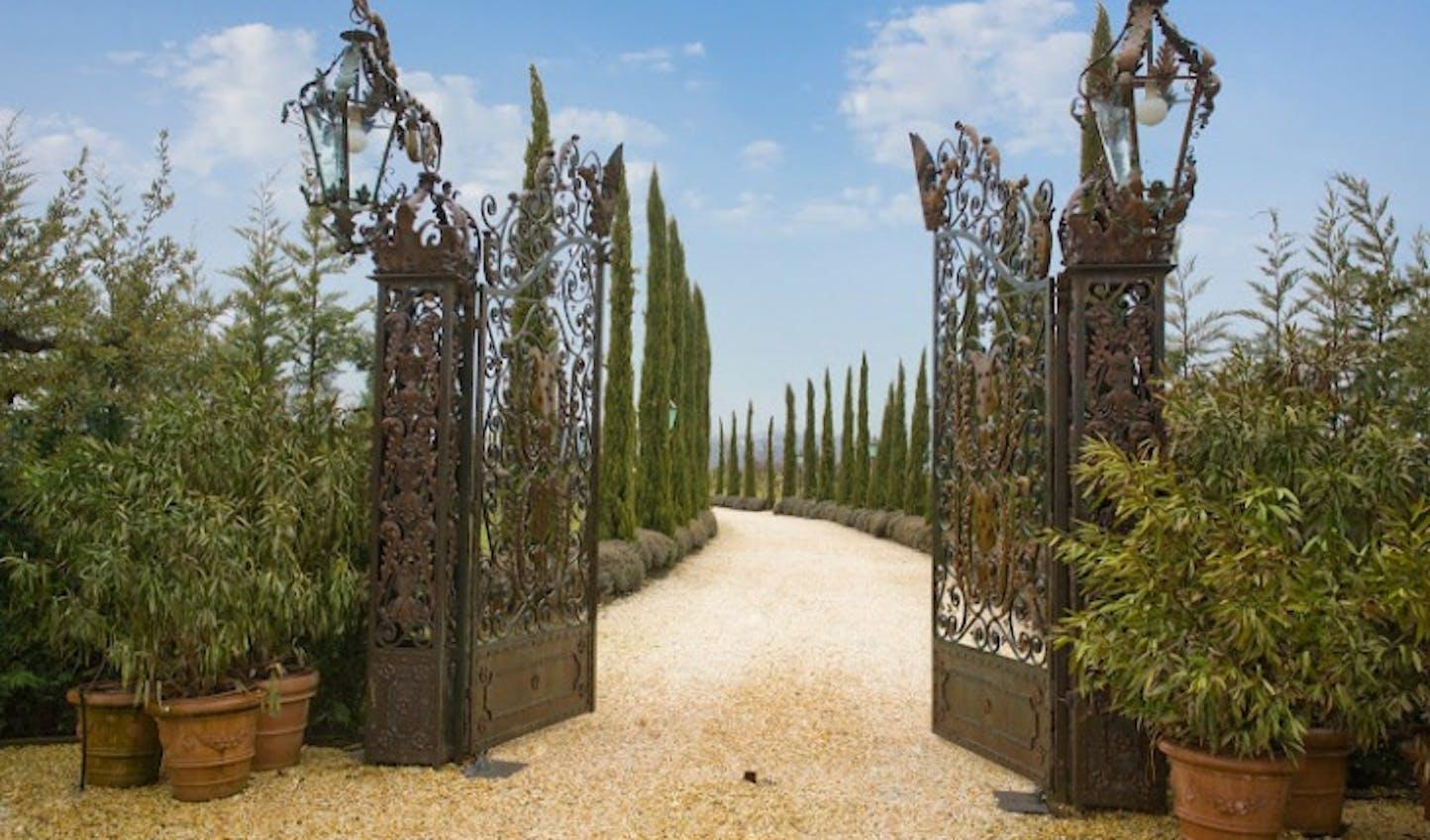 The intricate iron gateway to Borgo Santo Pietro