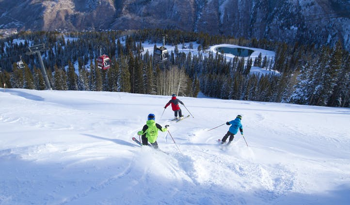 Skiing down steep mountains in Aspen Snowmass