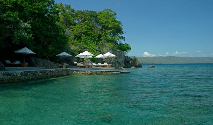 Luxury hotel boardwalk and sea at Amanwana on Mojo Island, Indonesia