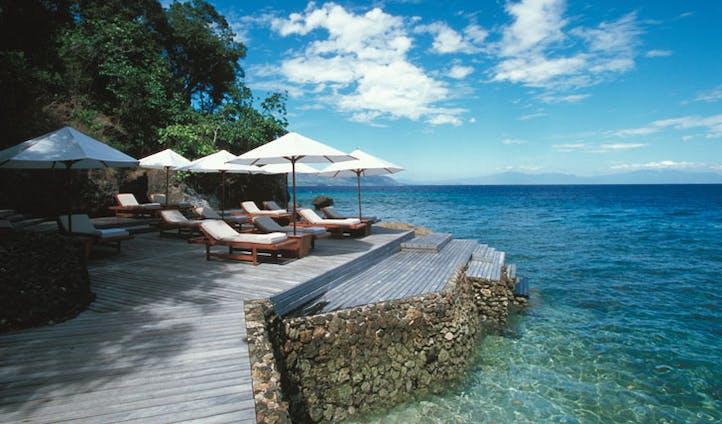 Luxury hotel boardwalk at Amanwana on Mojo Island, Indonesia