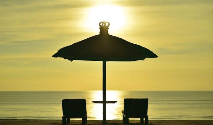 Luxury hotel beach at Jimbaran Puri, Bali, Indonesia