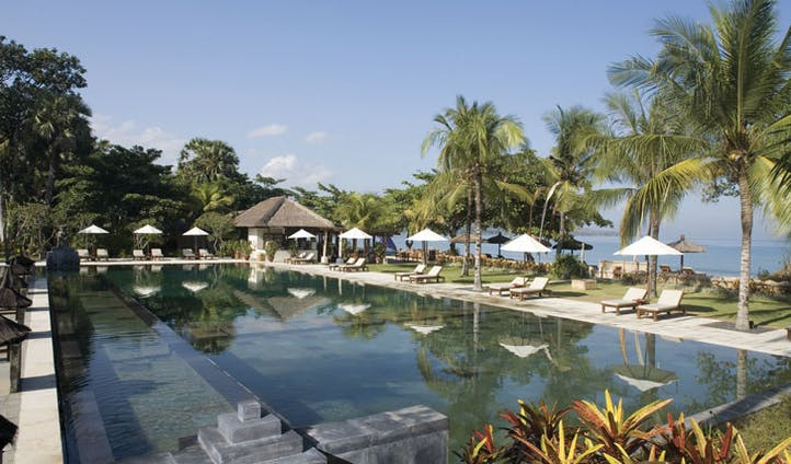 Luxury hotel pool at Jimbaran Puri, Bali, Indonesia