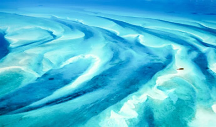 Swirling sands in the Bahamas | Black Tomato
