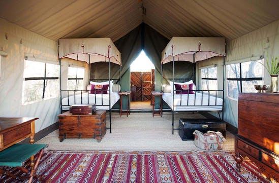 The twin tent has beautiful furniture