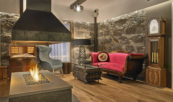 An open fireplace burns at your Reykjavik hotel