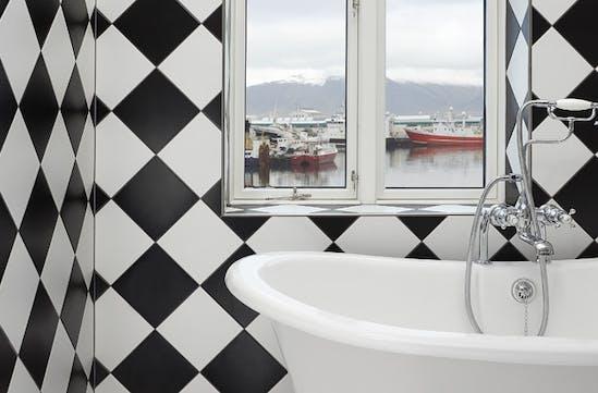 A bathroom overlooking the harbour in Reykjavik