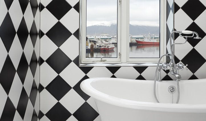 A bathroom overlooking the harbour in Reykjavik