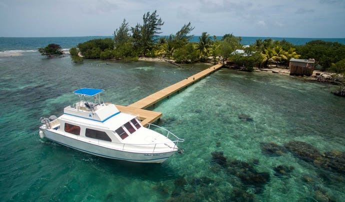 Stay on your private coral reef in Belize