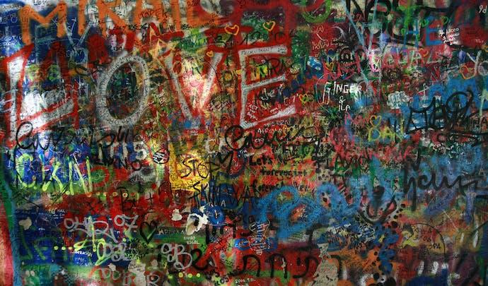 Visit the John Lennon wall in Czech Republic