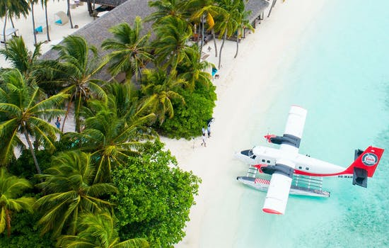 Arrive by plane to the Maldives